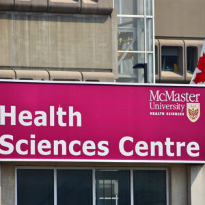 Mcmaster,Health,Science,Center,With,The,Canadian,Flag,Beside,It,