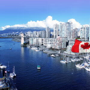Canadian,Flag,In,Front,Of,View,Of,False,Creek,And